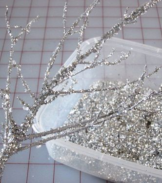 Tutorial: DIY Sparkle Branches. Great Christmas Baby Shower Decorations. Super Easy: Branches. Silver paint. Spray adhesive.