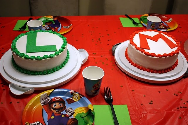 """Simple and easy to create with the infamous """"M"""" and """"L"""" logos for Mario and Luigi! Perfect for any video gamer's liking of the two infamous characters. Notice the plate settings as well. Mario themed party is definitely a great event to host and easy to duplicate. So many ideas / inspirational thoughts can come from looking at this photo!"""