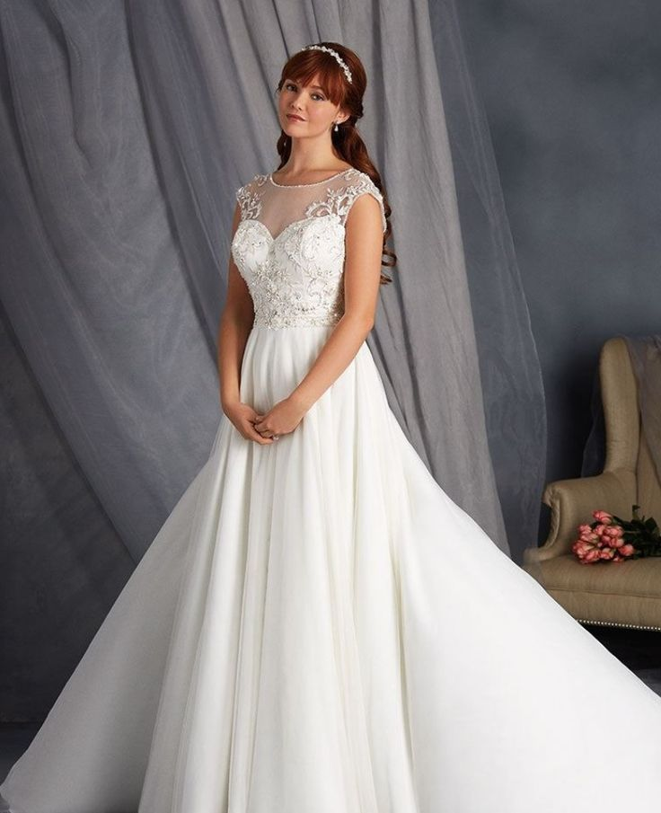This elegant beauty features a back detail. It is