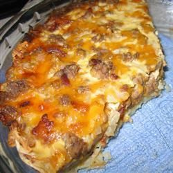 Hamburger Quiche Recipe - Good! Greased pie plate with bacon grease and baked crust at 400 degrees to brown faster. Used Italian blend cheese in filling. Also used real bacon.