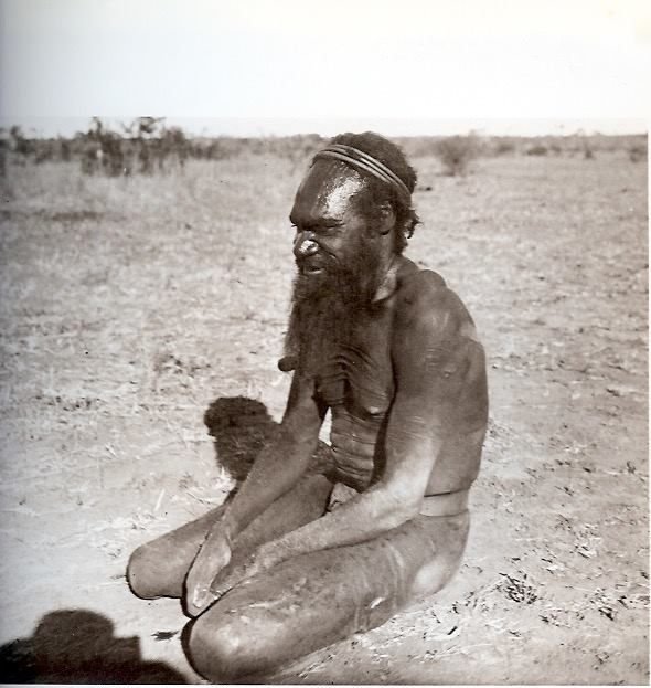 """Waramanga man wearing a woman's head-rings as a magic cure for headache. Tennant Creek 1901"". From The Aboriginal Photographs of Baldwin Spencer, 1982."