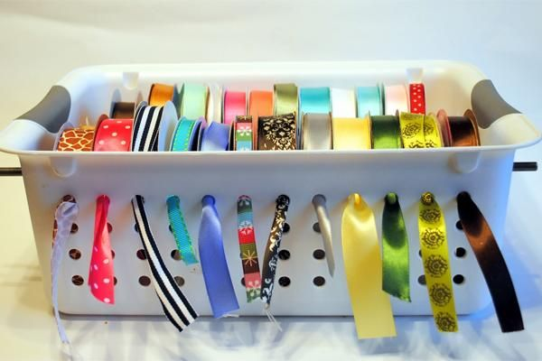 Avoid tangled ribbons and showcase your favorites with this ridiculously simple ribbon organizer tutorial using a slotted laundry bin