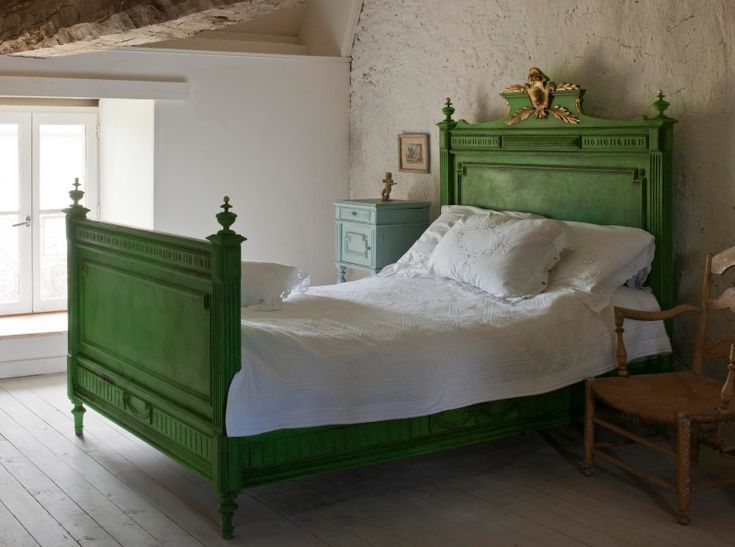 French Napoleonic bed painted in Antibes Green Chalk Paint®. The classical laurel leaves and shield in the bedhead are gilded. The walls and nightstand are also painted with Chalk Paint®. | Project by Annie Sloan and featured in her book Color Recipes for Painted Furniture