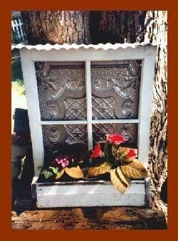 Tin ceiling tile, old window and reclaimed wood planter