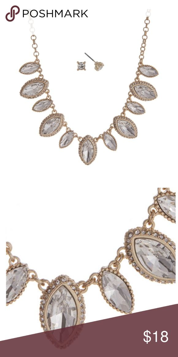 """Clear and Gold Statement Necklace w/ Earrings Gold tone necklace set displaying clear marquee shape cabochons. Approximately 15"""" in length. Set includes matchings clear stud earrings. Jewelry Necklaces"""