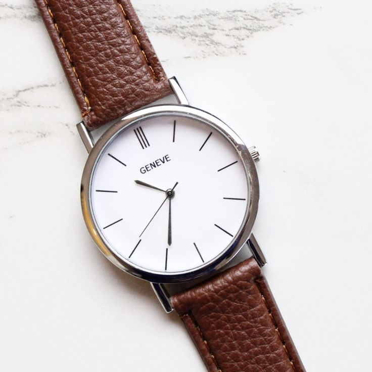 FREE SHIPPING! A modern watch with brown vegan leather strap and silver-plated dial. This chic timepiece is perfect for stacking this Summer season!