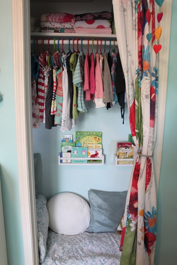 Children's closet turned cozy book nook - she loves playing in her closet anyways!