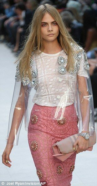 Burberry SS14 Embellished: Bailey sent a quirky cape in clear plastic embellished with gems down the runway