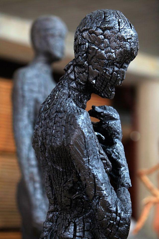 Burned wood sculpture by Aron Demetz