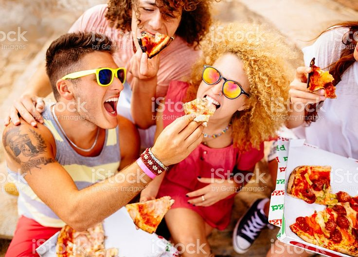Friends Eating Pizza royalty-free stock photo