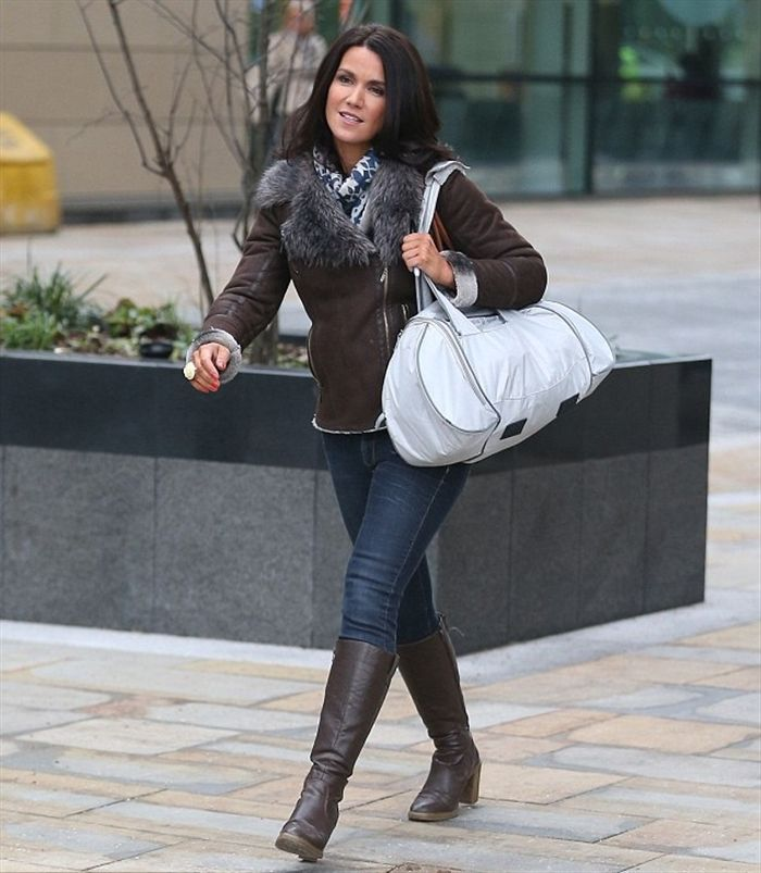 susanna wearing skin tight with knee high boots