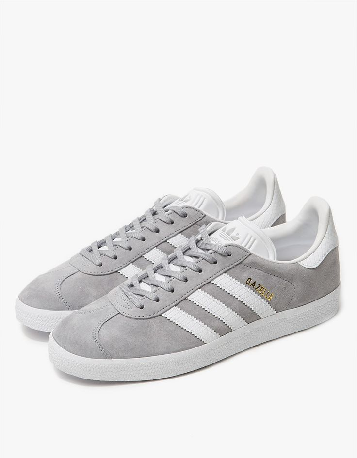 Classic Gazelle sneaker from Adidas. Grey nubuck upper with textured White leather accents. Lace-up front with flat cotton laces. Molded heel cage and eyestay. Retro 3-stripes at medial and lateral sides. Leather lining and sockliner. Textured rubber outs