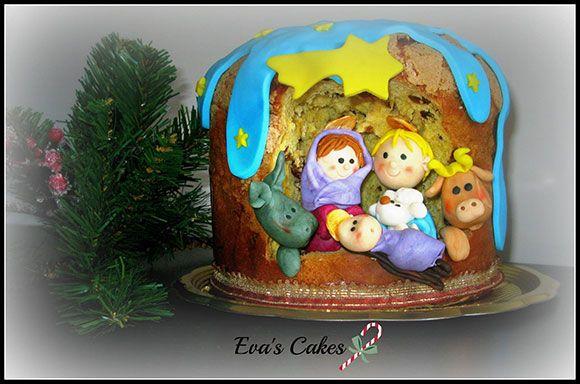 Panettone decorato a mano con un presepe in pasta di zucchero. Handmade panettone with nativity scene.