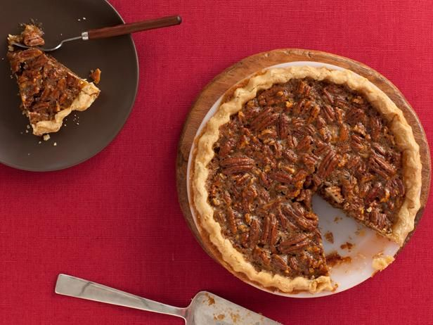Pecan Pie : No tricks or surprises here: Food Network Kitchen's Pecan Pie recipe is classic, straightforward and super-dense with crunchy nuts. You can use your food processor for making the dough, but we think your hands are the best tool.