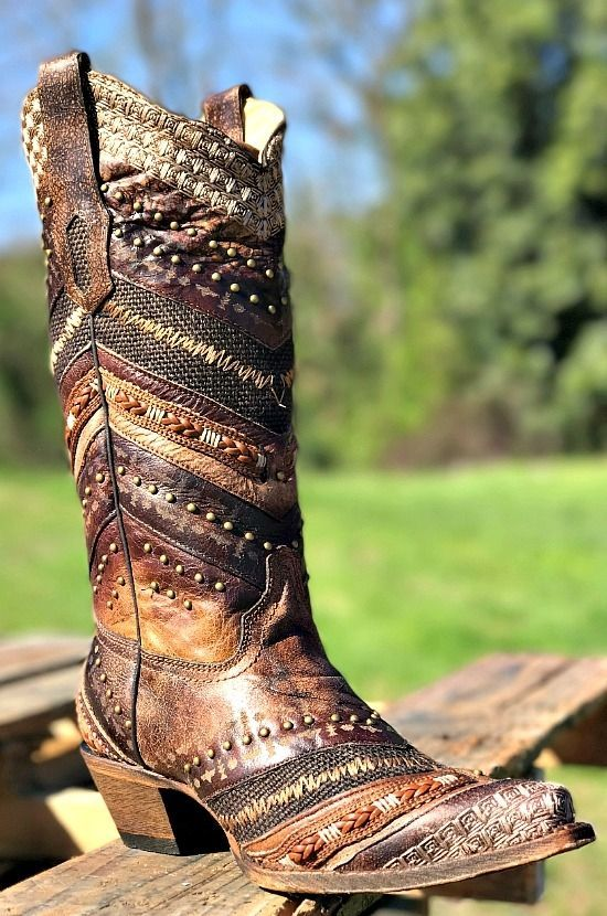 These gorgeous Brown Embroidered and Studs Boot by Corral feature a chevron mix of braids, studs, leathers, and embroidery. The intricate detailing on this boot is stunning! #cowgirlboots