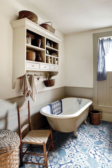 Love the blue patterned tiles in this bathroom in contrast with the neutral colour