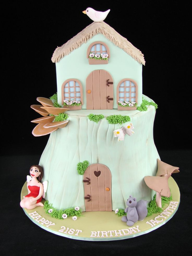 Fairy House on Stump:  Red Velvet cakes with buttercream and decorated with fondant. — at Wyndham Resort.