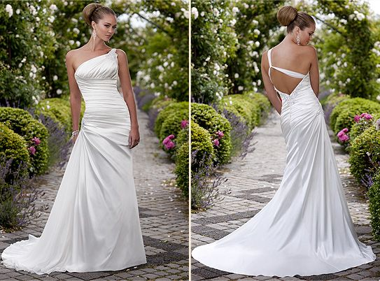 Beautiful one shoulder wedding dress with very low back