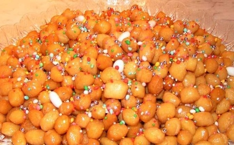 Struffoli napoletani, another food of the Gods made in Italy (Napoli). Delicacy made of flour and honey.