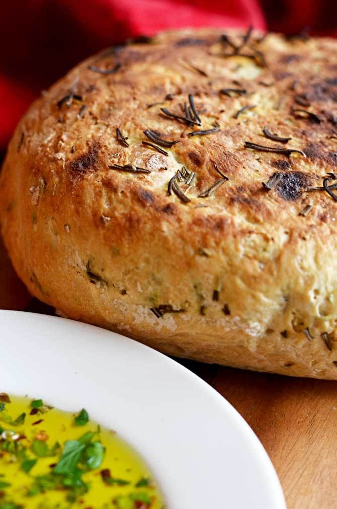 Rosemary Olive Oil Crock Pot Bread!  That's right, this bread is actually made in the slow cooker, and it comes out so tender and flavorful!  It's become one of my most popular recipes of all time! | hostthetoast.com