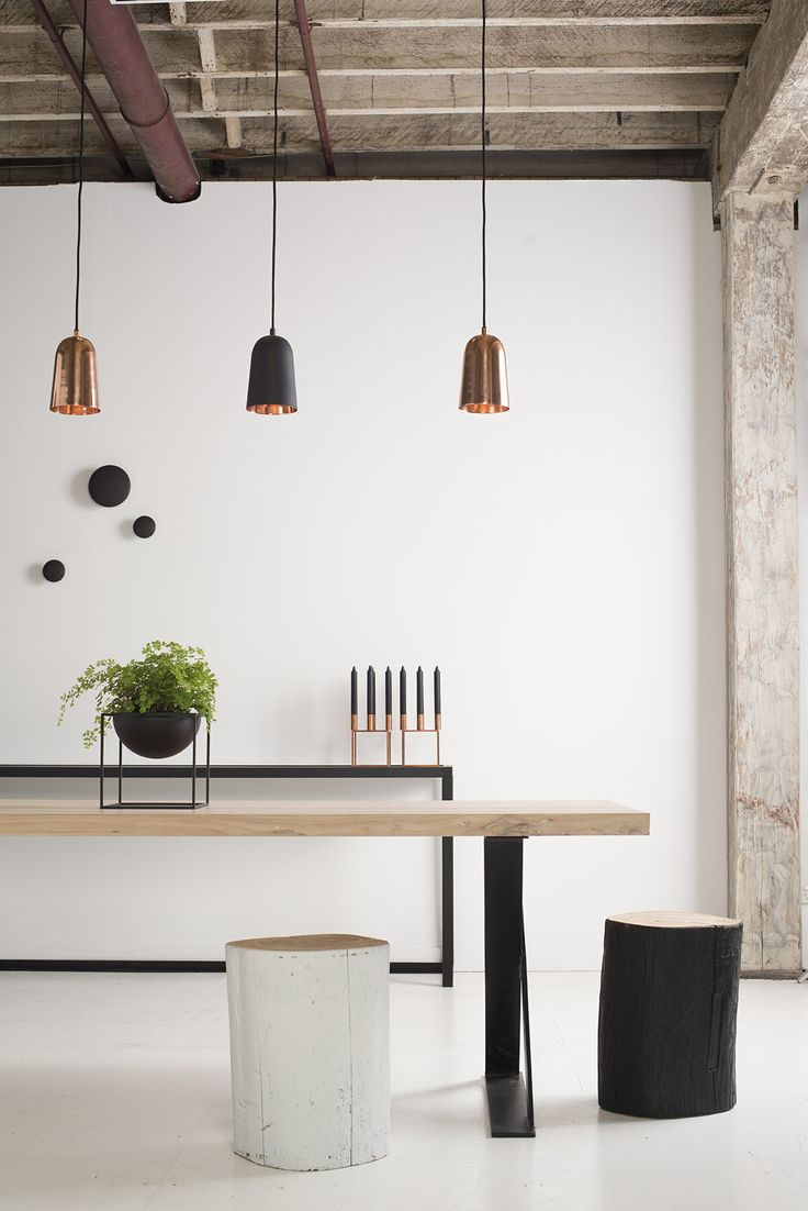 Hudson Reclaimed Elm Wooden Dining Table, Tonk Log Stools, Muuto Black Wall Dots, Kubus by Lassen Bowl and Candleholder and Hanging Danish Pendant Lights.