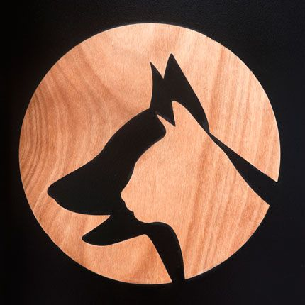 Veterinary clinic logo - stencil technique with black paint on wooden surface