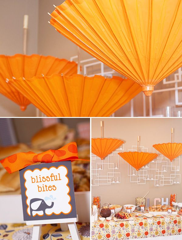 These upside-down paper umbrellas add a bright pop of color to your baby shower. #ideas #babyshower #wedding