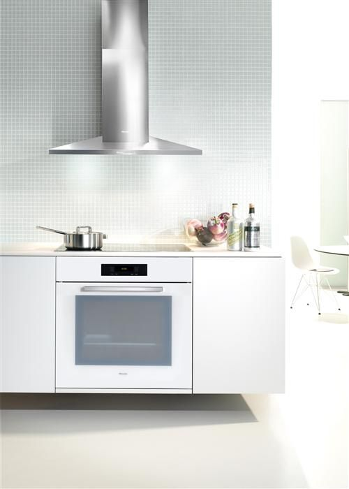 Selecting white appliances, such as this Miele Oven in Brilliant White, allows you to experiment with colourful walls and splashbacks, ensuring any future changes have neutral grounding features #kitchendesign