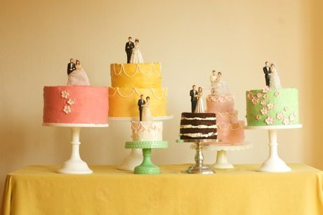 vintage cake toppers on cake table cakes