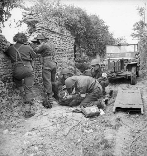 Chaplains work closely with members of R.A.P. and aid in evacuation of wounded, 3 Canadian Infantry Division. July 1944 Caen area, France. | Flickr - Photo Sharing!