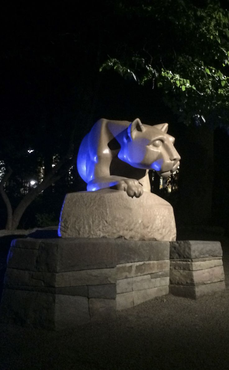 Bathed in blue, the Nittany Lion keeps watch of Penn State at night.