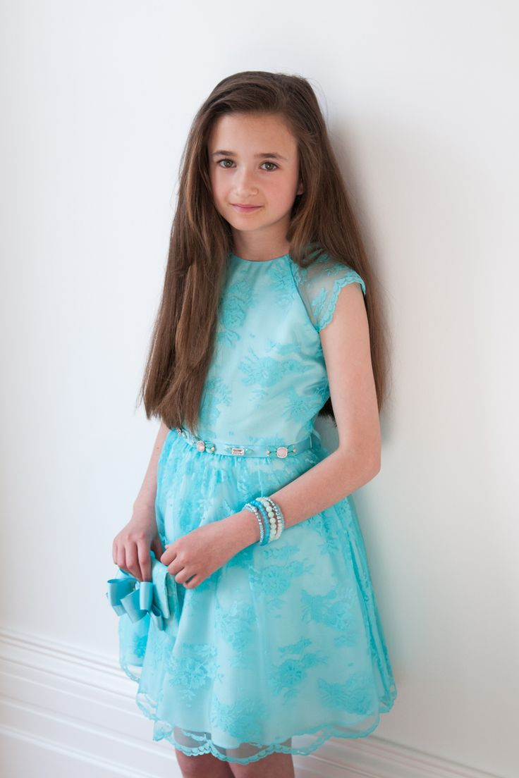 Introducing one of our finest occasion wear dresses, the light turquoise girls dream dress. Perfect for spring time weddings and parties, this feminine find will leave your child looking and feeling first class. The dress is available in a light shade of turquoise and benefits from having a matching lace overlay with floral design. With an elegant cutaway design and pleated skirt, this dress will fit like a charm. Your little fashionista will fall in love with the jewelled ribbon detail…