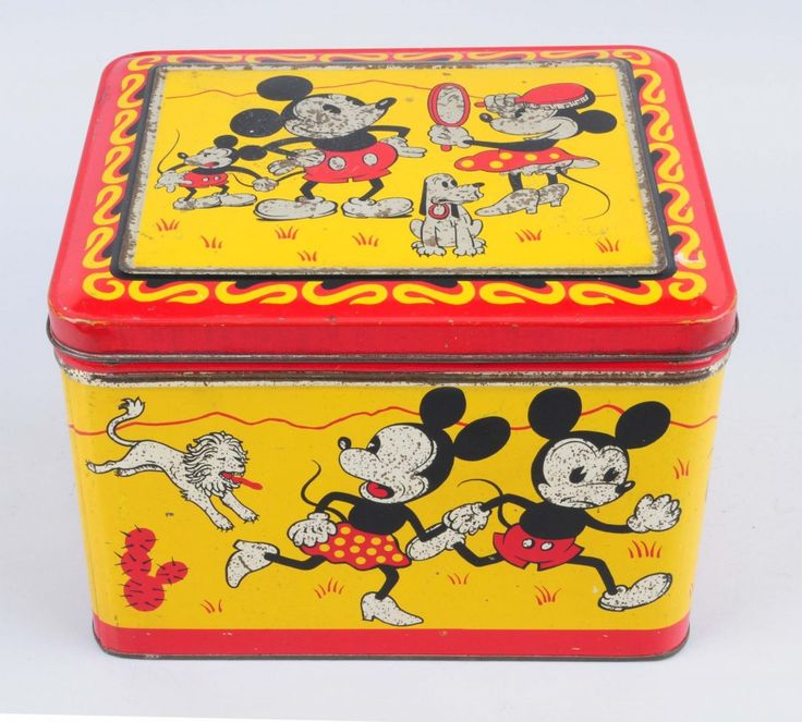 """Scarce Disney Mickey Mouse Large Tin Box - Circa 1930s, Hoffmann, Switzerland. Features Minnie, Mickey, his nephew, and Pluto. Unusual graphics of Mickey and Minnie running from a lion. Small scattered spots of litho loss, some slight oxidation and wear on raised and rolled edges. Condition (Good Plus). Size 10"""" x 7"""". - MAY 2015 - Estimate $600 – $900 Starting Bid $150"""