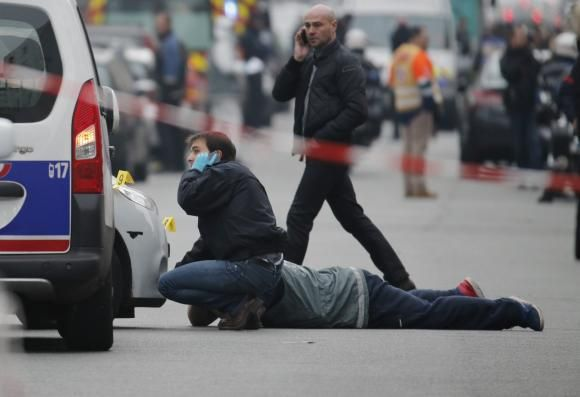 Paris terror attacks: eight attackers dead after killing at least 120 people