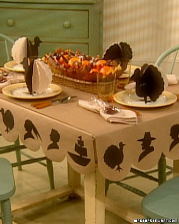 Kids table cover made from brown craft paper and black construction paper. Turkey coloring book plate toppers