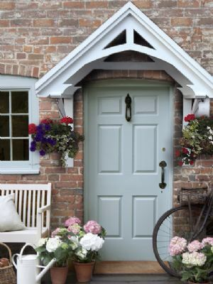 Stain same colour as fence / white gloss front door  The Isabelle door canopy stands 25 inches (635mm) from the house wall and the top of the frame sits approx 26 Inches (660mm) above the door frame.  Our Price: £188.00 http://mudputty.co.uk/isabelle-door-canopy-98-p.asp