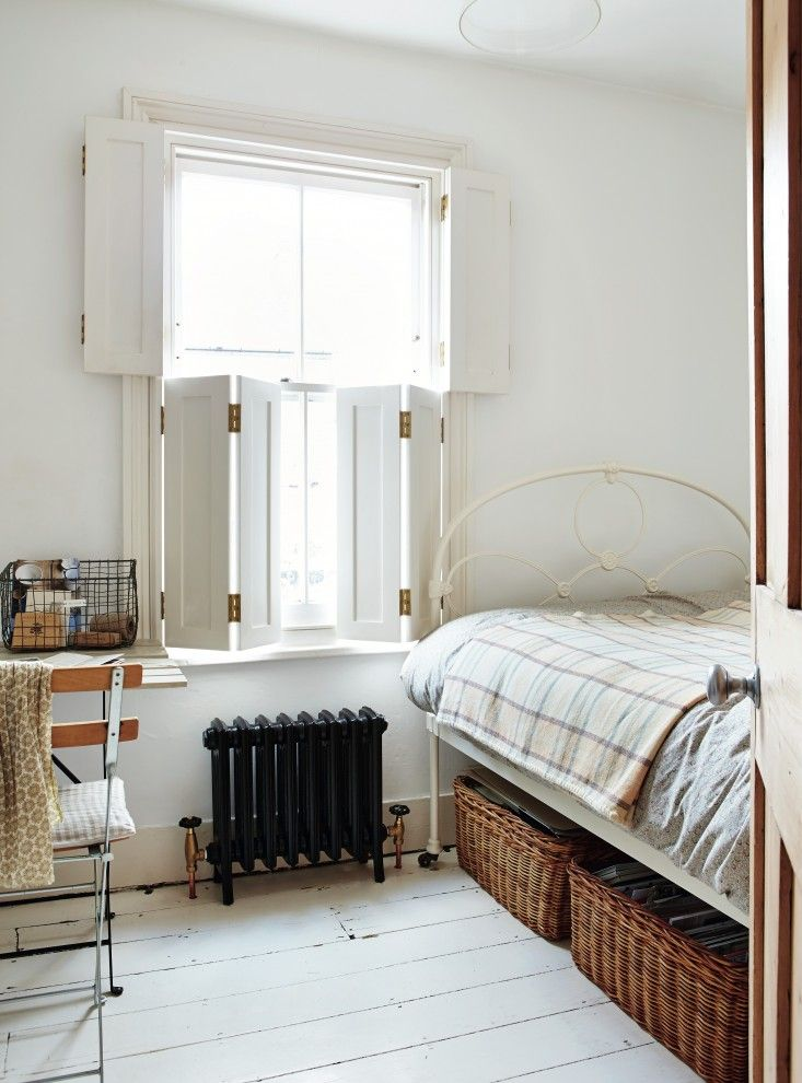 Sara Emslie's House in Beautifully Small, Photos by Rachel Whiting, Under bed basket storage in guest room | Remodelista