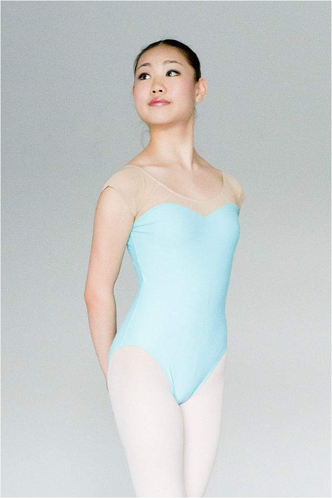 This beautiful nude mesh and Lycra mock tube leotard features shelf lining and a ballet cut leg line. The skin color mesh is very flattering as it highlights your neckline and shoulders. It looks good on its own or with a skirt.