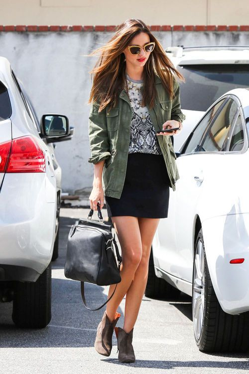 Shop Miranda Kerr's look for $123:  http://lookastic.com/women/looks/anorak-and-crew-neck-t-shirt-and-mini-skirt-and-shopper-handbag-and-ankle-boots/1178  — Green Anorak  — Grey Print Crew-neck T-shirt  — Black Mini Skirt  — Black Leather Shopper Handbag  — Brown Leather Ankle Boots