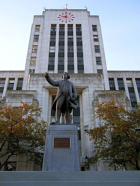 Vancouver's city hall and the statue of Captain Vancouver.