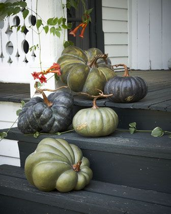 A very cool idea for the front entrance!  Five Faux Heirloom Pumpkins by Park Hill Collections at Horchow.