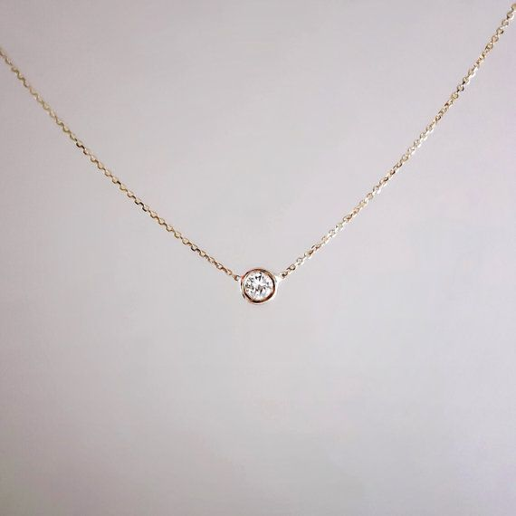 THE SEVEN SOLITAIRE DIAMOND NECKLACE - One of my best selling items. The perfect piece for layering! Featuring a .07 carat round diamond, G SI+  Set in a 14k or 18k gold bezel setting  Dimensions of the diamond: 2.7 mm  Available in 14k or 18k white, yellow or rose gold - 15 - 20 inches and custom upon request.  *The chains in the photos are all 14k gold cable chains, .05 mm. 18k gold cable chains measure 1.1 mm.   **Please note - The first photo features the 14k white, yellow and rose gold…