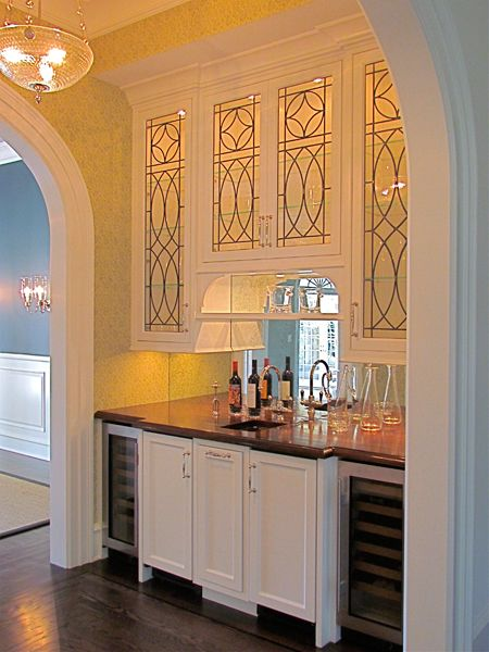 butler's pantry - like the mirrored back splash and leaded glass cabinet doors