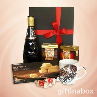 For the true coffee lover. A selection of coffees and coffee liqueur to be enjoyed with butter shortbread biscuits. Presented in a stylish presentation box with ribbons and bows   750ml Butlers espresso coffee liqueur 250g Douwe Egberts coffee - filter blend 250g Douwe Egberts coffee - intense 220g pure butter shortbread biscuits Coffee mug 2 x Cote D'or bouchee