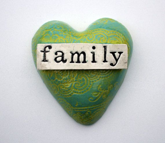 Beautiful duckegg blue and lime green heart with a family banner over the top. Handmade, and able to hang on the wall with wire on the back.
