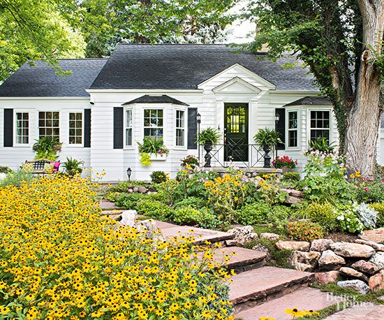 You won't believe what this garden looked like before! Using the original wide flagstone path, planting beds, and large American elm as starting points, the homeowners better defined the space by adding several large boulders and lighted walking paths. Fortunately, the bald lawn was an easy fix, though it required patience./