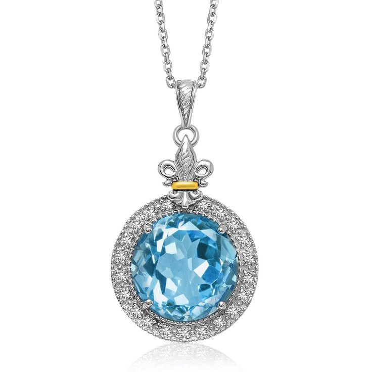 Wonderfully alluring, this round pendant features a dazzling blue topaz and .20ct diamond border accents. Embellished with a fleur de lis element, this beauty is crafted in 18K yellow gold and sterlin