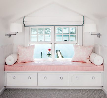 Built in window seat in a pink girl's room.  White roman shade with gray trim.  Love the storage under the built in bench and the water view! http://cococozy.com