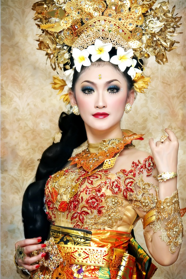 Bali girl in traditional dress. Beautiful headpiece!