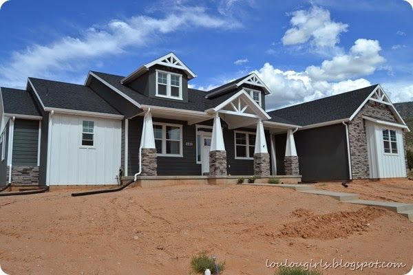 Here's the Dirt…Literally. Gray Craftsman style home, with white hardy board and batten and Iron Gray hardy plank style. Gray stucco and rock.